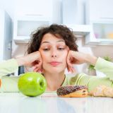 Lady deciding on good or bad food