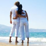 Young couple embracing on the beach