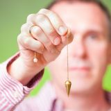Man swinging pendulum