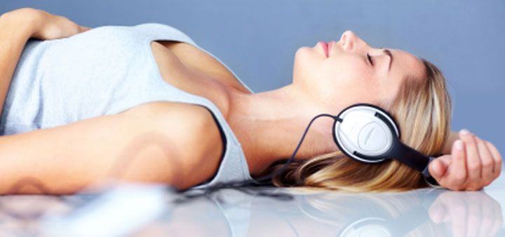 Lady laying down with headphones