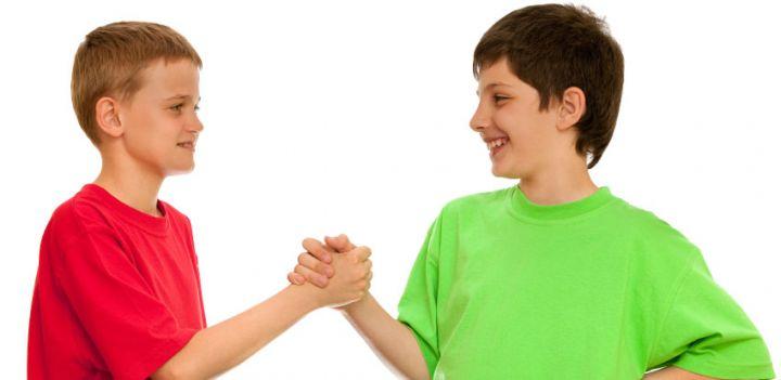 2 boys shaking hands