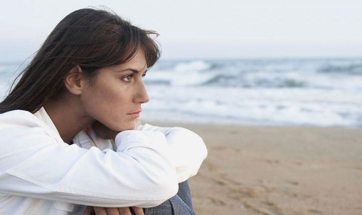 Woman daydreaming on beach