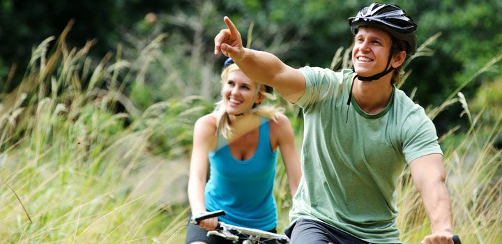 Happy man and partner riding their bike